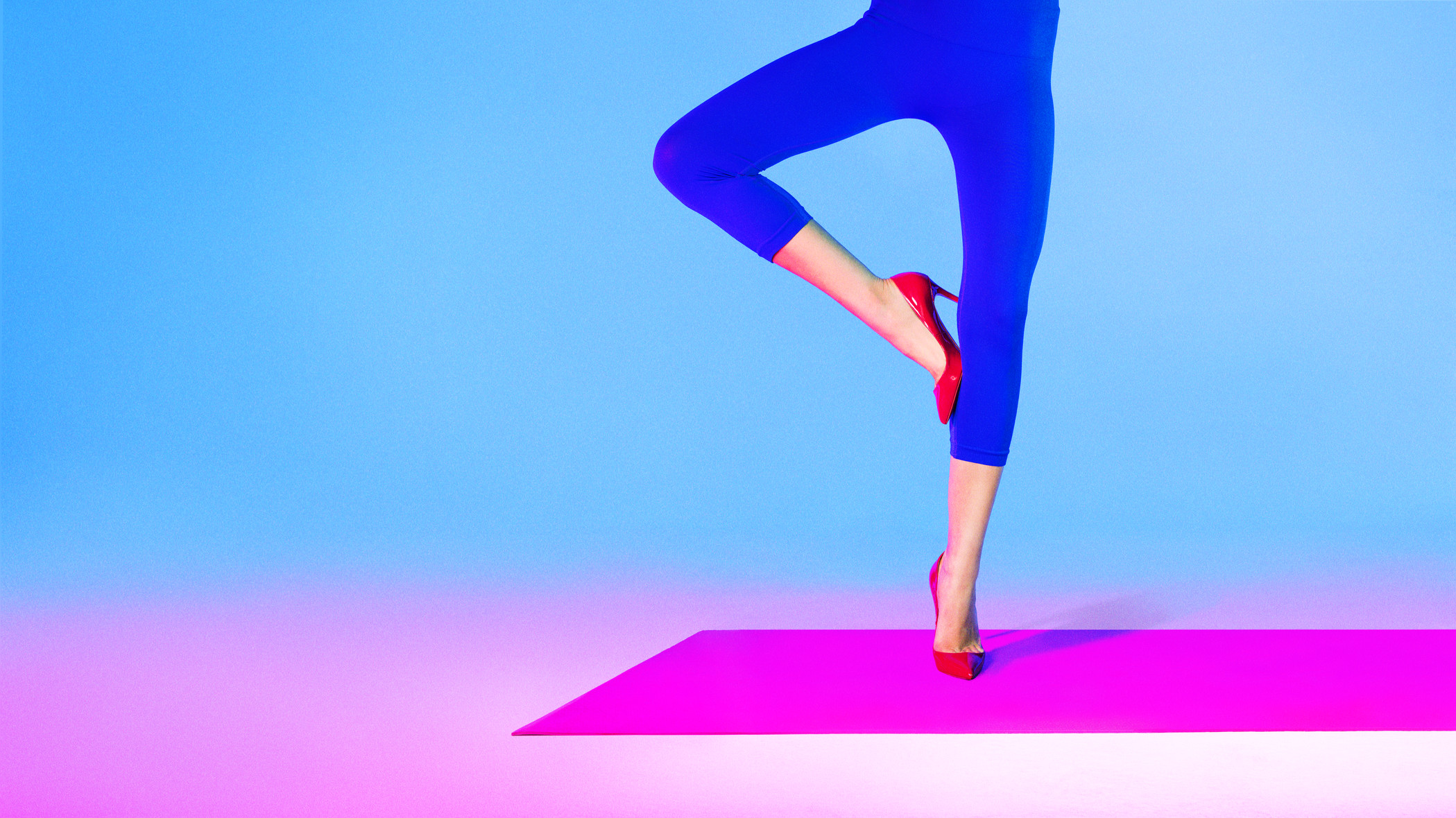 woman wearing blue yoga pants and red high heels