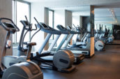 gray and black elliptical trainers in a gym