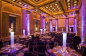 event venue room with neon lights and round tables
