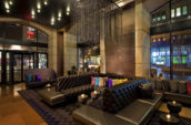 modern lobby room with leather couches and large windows