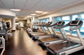 black and gray treadmills in a gym
