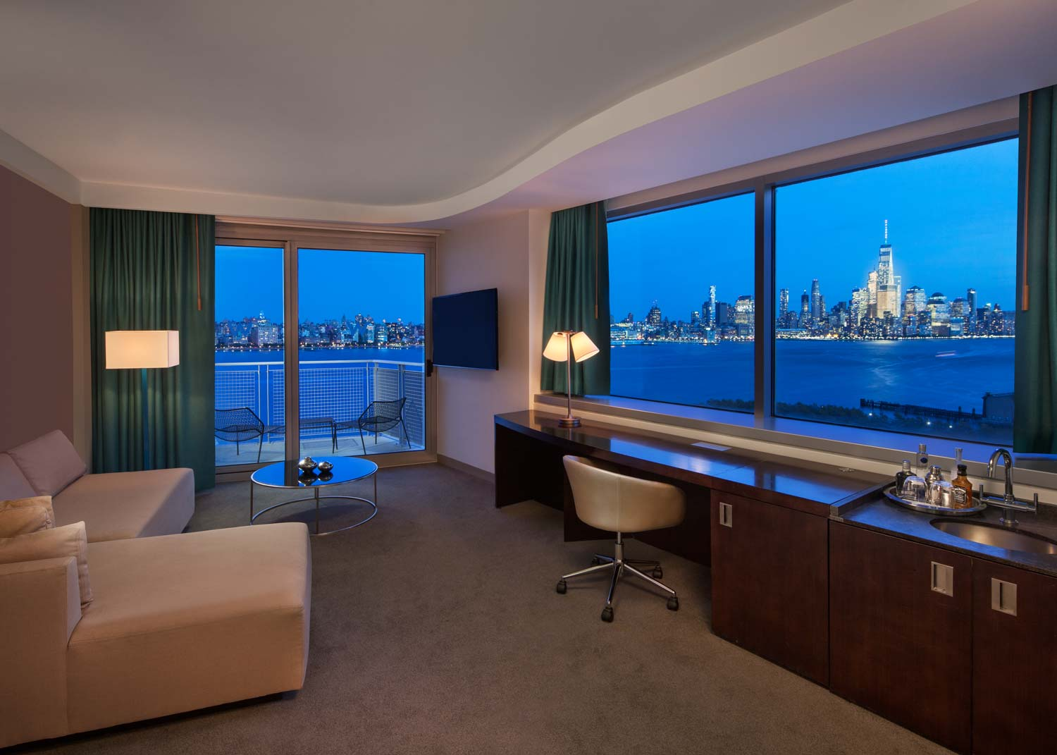 Living Room Suite overlooking river and New York Skyline at night