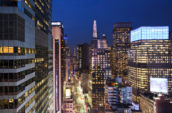 aerial photography of curtain wall high-rise buildings during night