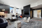 square two-toned coffee table with couches in a modern living room