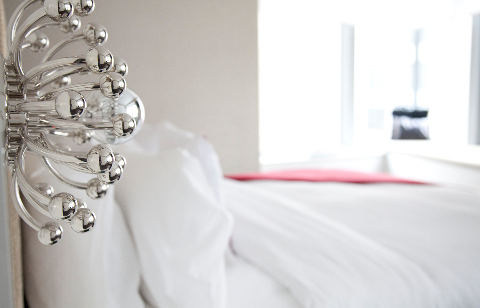 empty white bed with white comforter and pillow
