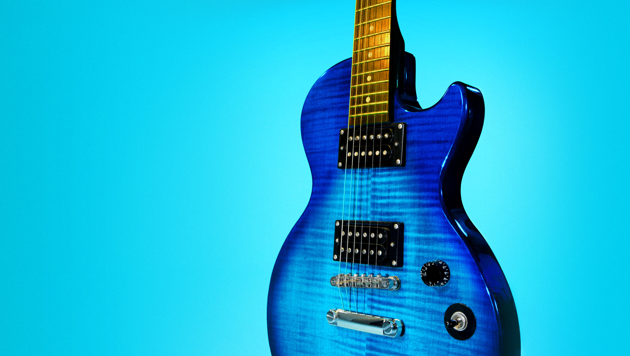 blue and black electric guitar