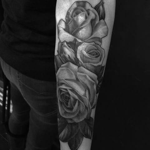 rose flowers arm tattoo
