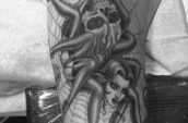 grayscale photography of woman and spider tattoo