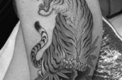 grayscale photography of male tiger tattoo