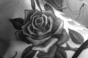 grayscale photography of rose tattoo