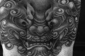 black Chinese guardian lion tattoo