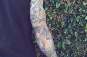 person with floral right arm tattoo standing