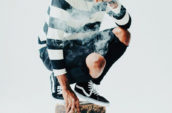 crouching man smoking