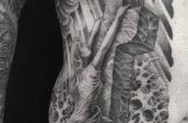 woman holding cross tattoo