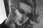 grey woman's face neck tattoo
