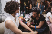 woman tattooing another woman