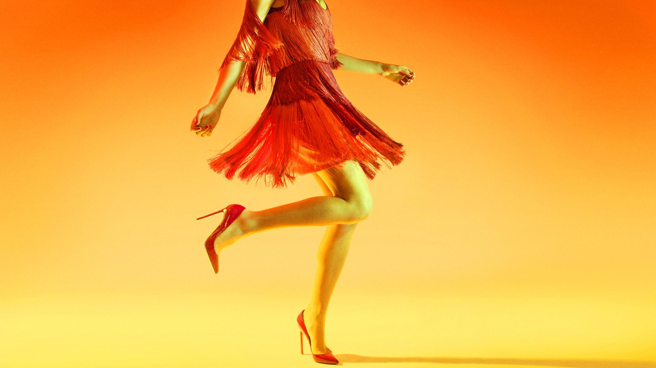 woman wearing orange dress
