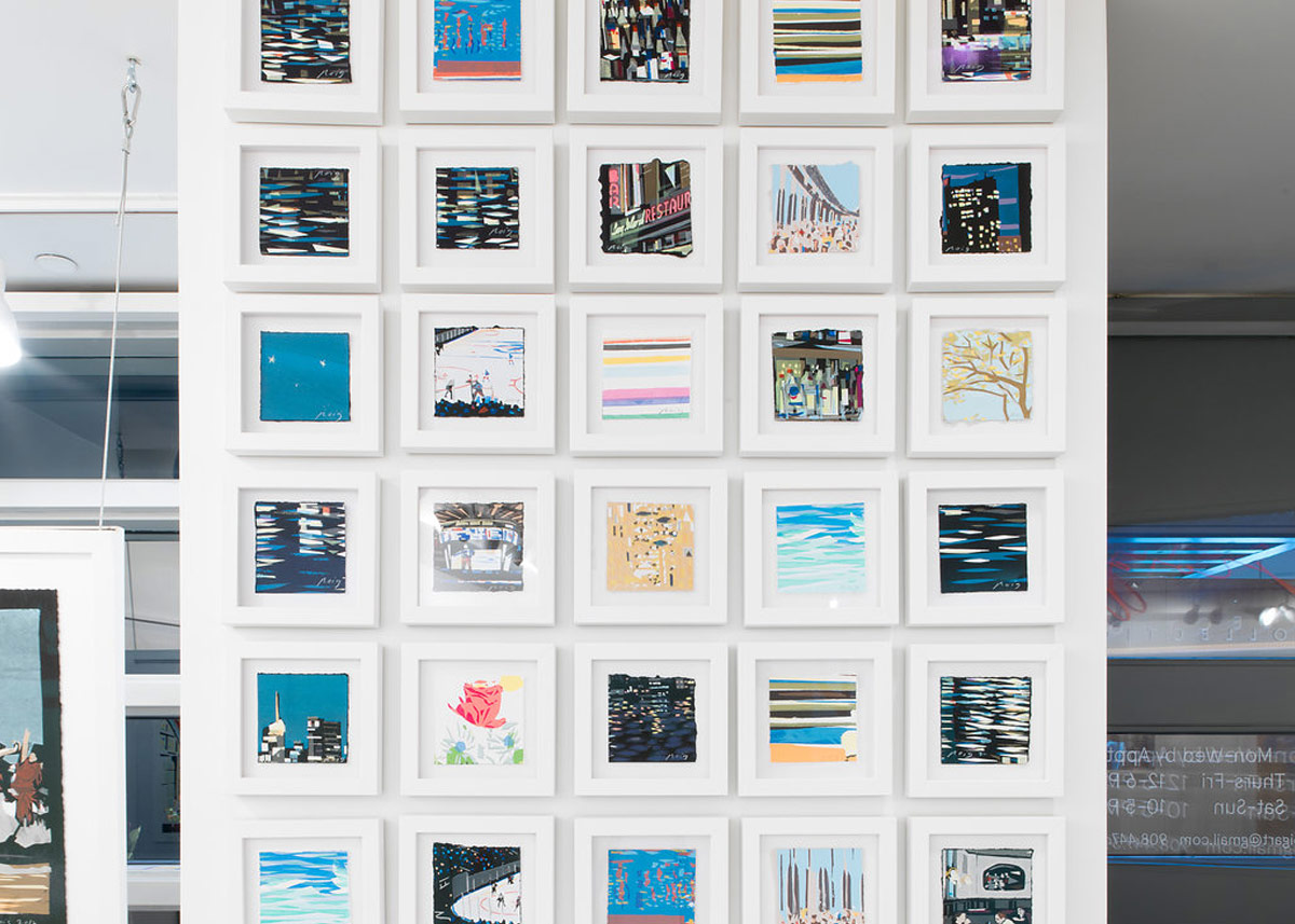 group of artwork hanging on a wall