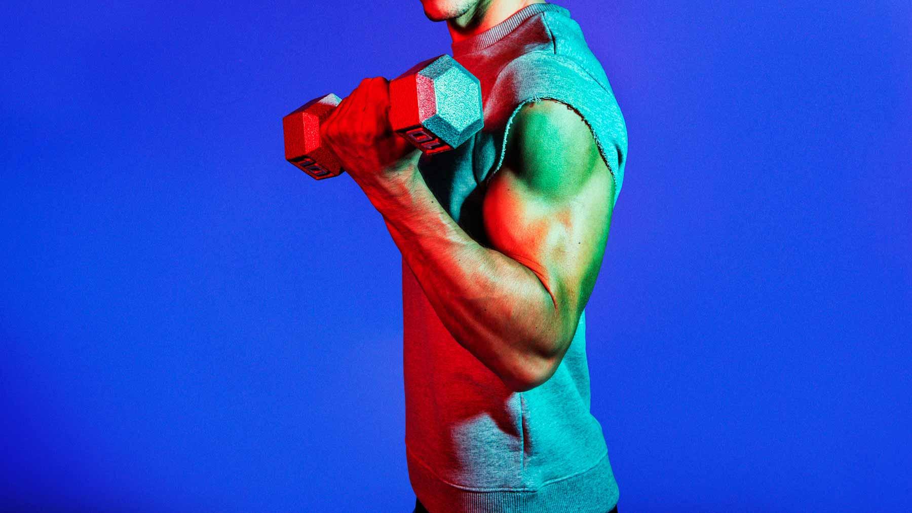 men lifting weight in gray sleeveless shirt