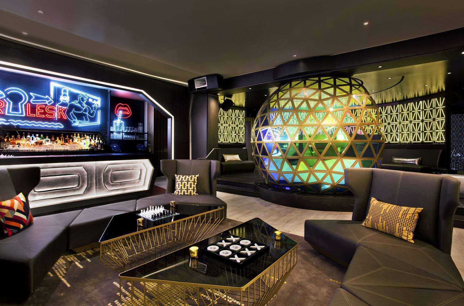 lounge room with two leather couches and modern decor